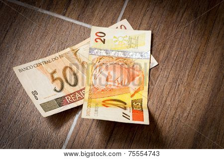20 and 50 Reais on the floor (Brazilian Money)