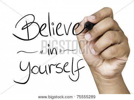 Believe in Yourself hand writing with a black mark on a transparent board