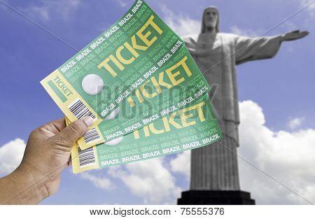 Hand holds soccer tickets in Rio de Janeiro, Brazil