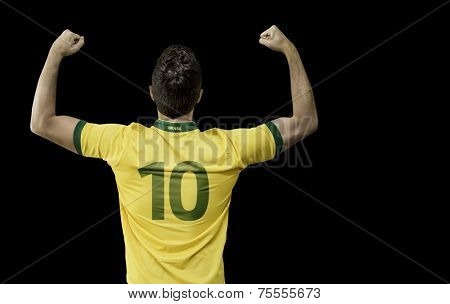 Brazilian man celebrates on black background
