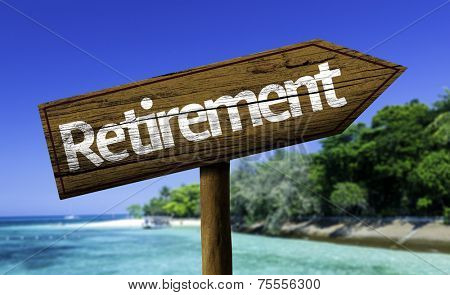 Retirement wooden sign with the beach on background