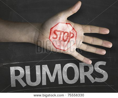 Educational and Creative composition with the message Stop Rumors on the blackboard