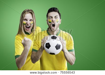 Brazilian couple celebrate on green background. Can be used as Australian uniform too.