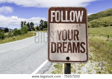 Follow your dreams road sign on the road