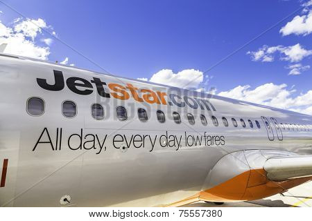 MELBOURNE, AUSTRALIA - CIRCA JAN 2014: Jetstar Airways aircraft in Melbourne airport. Jetstar Airways is an Australian low-cost airline headquartered in Melbourne, Australia.