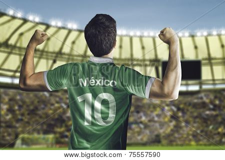 Mexican soccer player celebrates with the fans on the stadium
