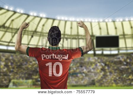 Portuguese soccer player celebrates with the fans on the stadium