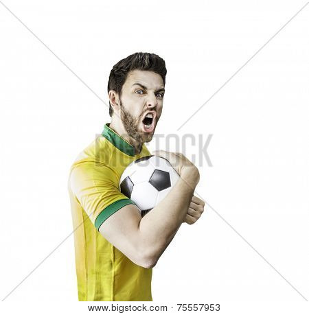 Brazilian soccer player holding a ball celebrates isolated on white background