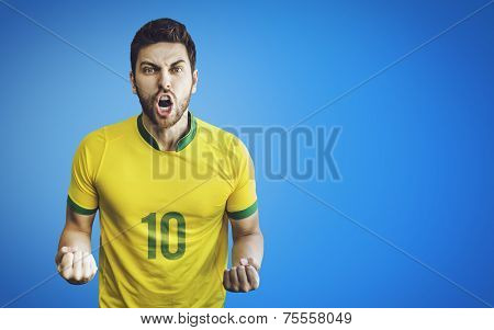 Brazilian soccer player celebrates on blue background. Can be used as Australian uniform too