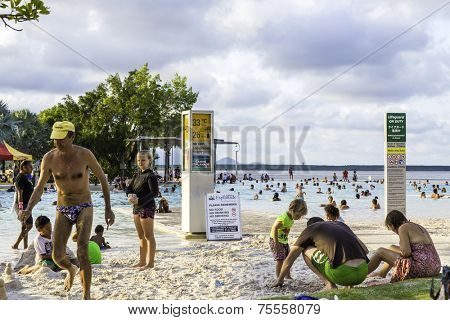 CAIRNS, AUSTRALIA - CIRCA JAN 2014 - People enjoy a hot day at Cairns Esplanade. The Cairns Esplanade is a public swimming lagoon in Cairns, Australia.