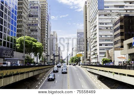 SAO PAULO, BRAZIL - CIRCA 2013: Traffic on Paulista Avenue in Sao Paulo, Brazil. Paulista is one of the most important avenues in Sao Paulo with 2.8 kilometer of thoroughfare.