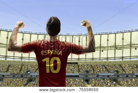 Spanish soccer player celebrates on the stadium with the fans