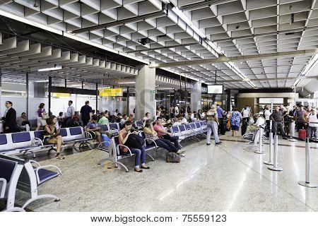 SAO PAULO, BRAZIL - CIRCA MARCH 2014: Passengers prepare to check-in at Guarulhos Airport in Sao Paulo, Brazil. Guarulhos is the main airport serving Sao Paulo, Brazil.