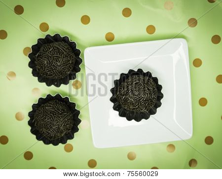 Traditional Brazilian Brigadeiro on Green background