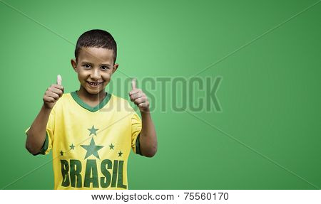 Brazilian fan boy celebrates on green background