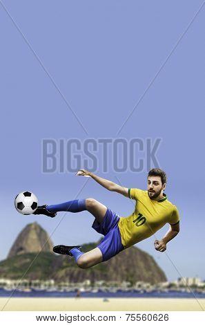 Brazilian soccer fan jumps kicking the ball in Rio de Janeiro, Brazil