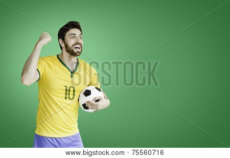Brazilian soccer player celebrates on green background