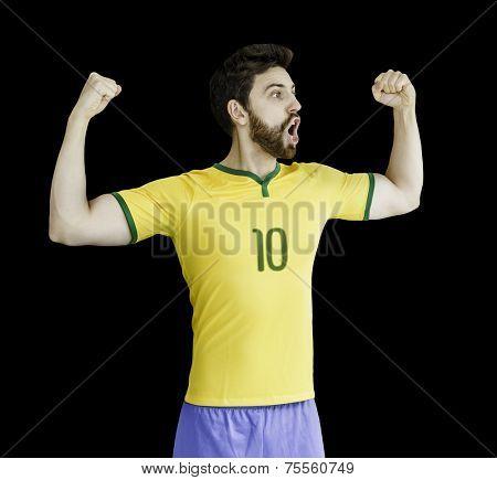 Brazilian soccer player celebrates on black background