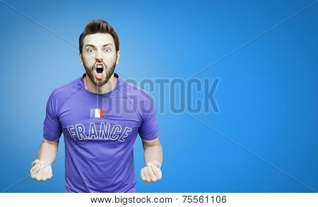 French soccer player celebrates on blue background