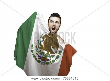 Fan holding the flag of Mexico celebrates on white background