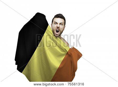 Fan holding the flag of Belgium celebrates on white background