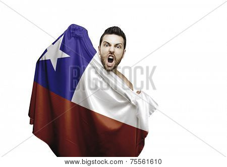 Fan holding the flag of Chile celebrates on white background
