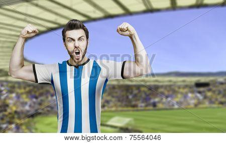 Argentinian soccer fan celebrates on the stadium