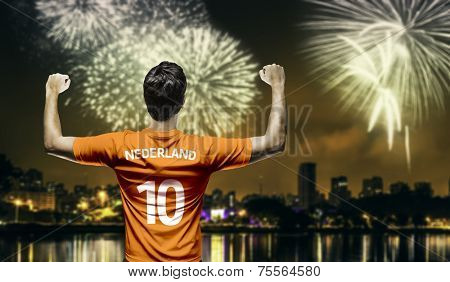 Dutchman fan celebrates the victory after the match