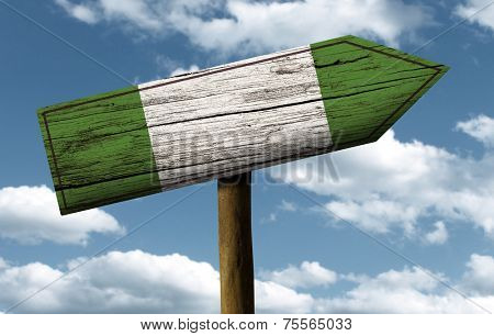 Nigerian flag wooden sign with a beautiful sky on background