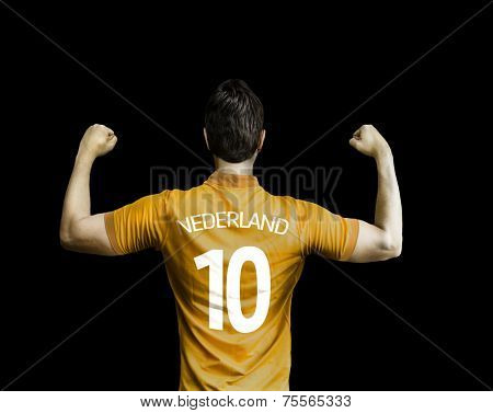 Dutchman soccer player celebrates on black background