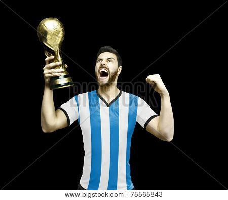 Argentinian soccer player celebrates the championship holding a trophy on black background