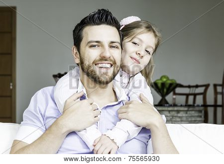 Daddy with his daughter having fun together