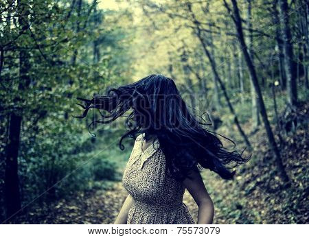Scared Girl Running In The Forest