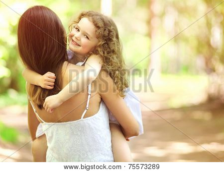 Joyful Child And Mother Having Fun, Friendly Family Walks Outdoors