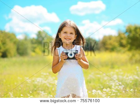 Cheerful Little Girl With Retro Camera In Summer Sunny Day