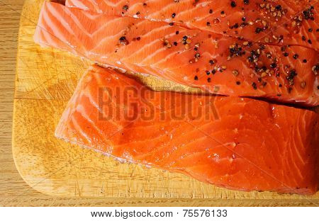 Marinated Salmon Fillets On The Wood Board
