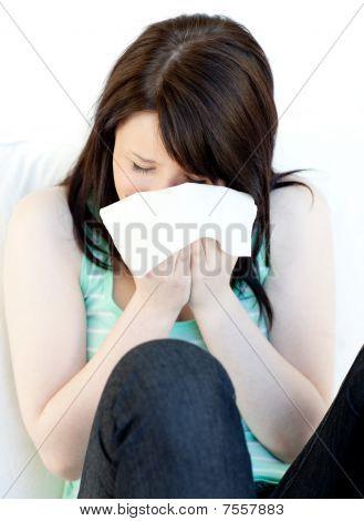 Portrait Of A Sick Caucasian Woman Blowing