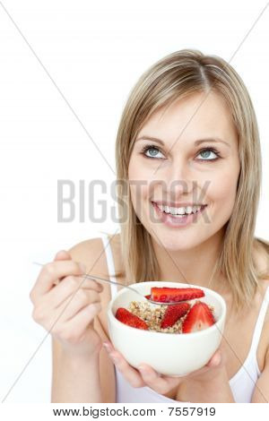 Smiling Woman Eating Cereals With Strawberries