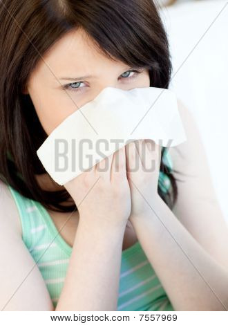 Portrait Of A Sick Caucasian Teen Girl Blowing
