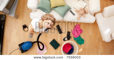 Tired Woman Vacuuming The Living-room