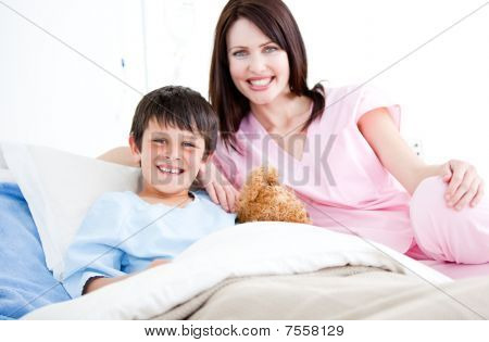 Smiling Little Boy With His Nurse