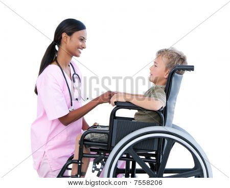 Cute Little Boy In A Wheelchair Discussing With His Doctor