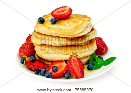 Flapjacks with strawberries and blueberries in plate