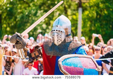 Knight In Fight With Sword. Restoration Of Knightly Battle