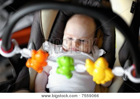 Little Baby Playing In A Carseat