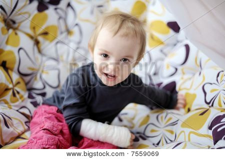Little Baby Girl With Bandaged Hand