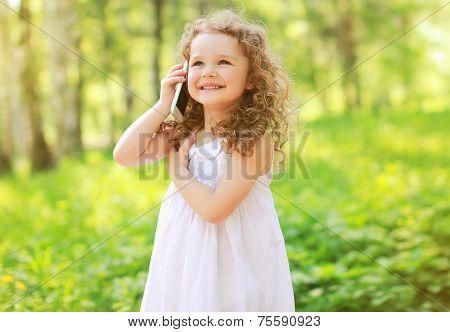 Happy Joyful Smiling Child Is Speaking On The Phone