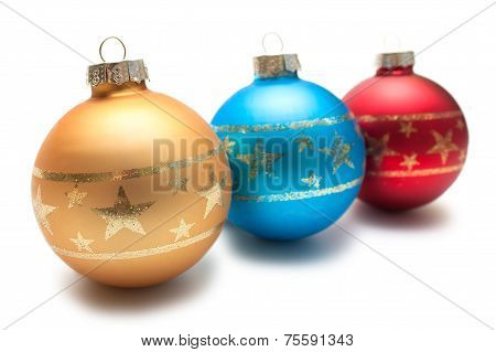 Three christmas balls in a row
