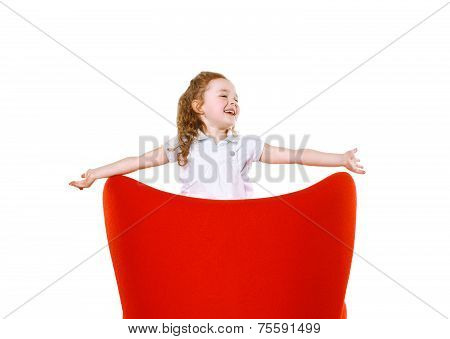 Joyful Little Girl In Red Chair