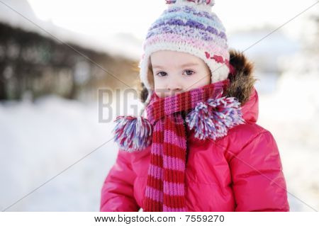 Little Girl Walking In A Purple Wintercoat